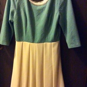 it's a mint green and cream dress New